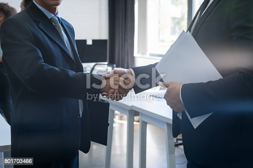 istock Handshake, Business People Shaking Hands After Meeting In Modern Office, Businesspeople Agreement 801703466