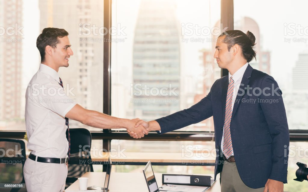 Handshake concept .Business people shaking hands, finishing up a meeting royalty-free stock photo