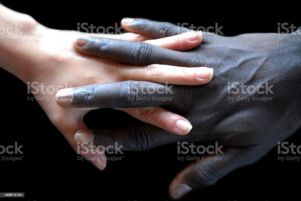 Handshake, concept of no apartheid. Hands black and white stock photo