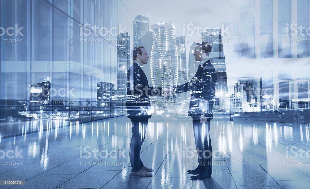 handshake double exposure stock photo