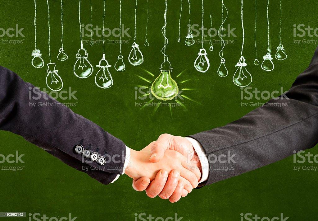 Handshake for a big idea stock photo