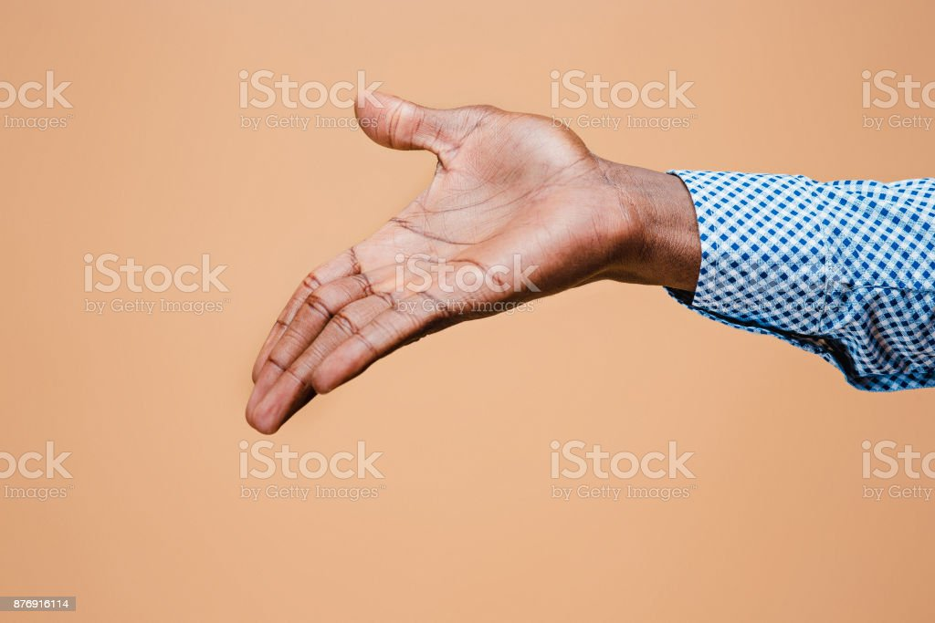 Handshake. Hands of businessman isolated on brown background stock photo
