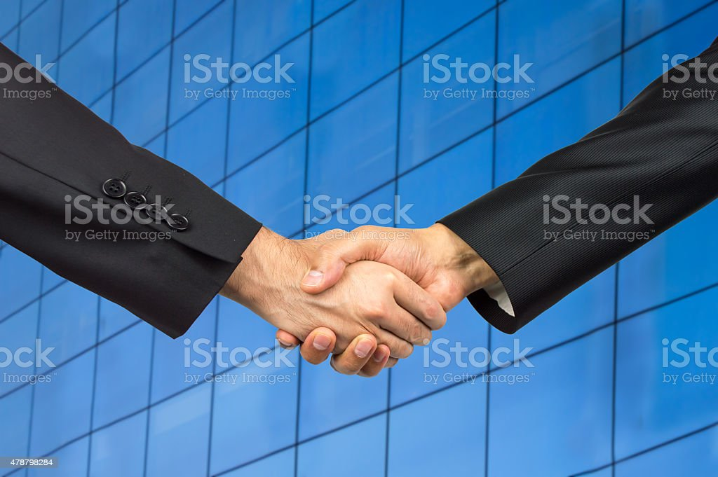 handshake in an office stock photo