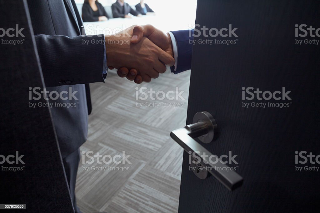 Handshake in office meeting room stock photo
