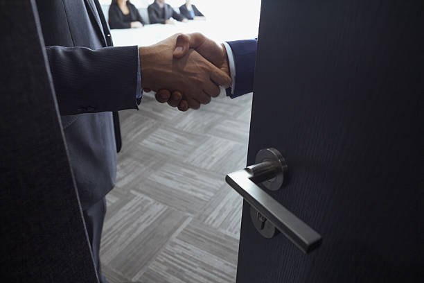 Handshake in office meeting room stock photo