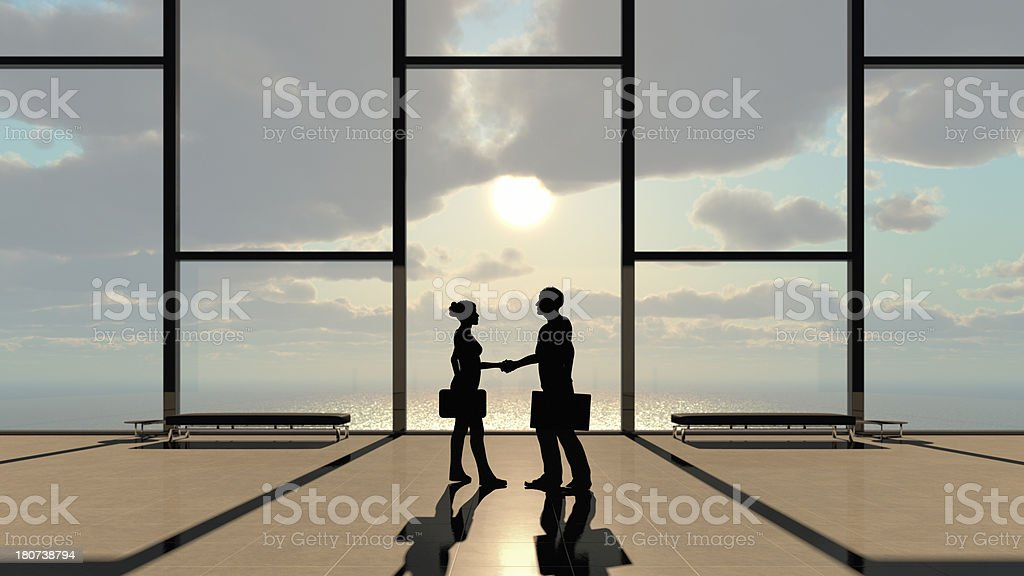 Handshake in Skyscapers Public Lobby above Sea royalty-free stock photo