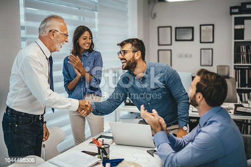 951514270 istock photo Handshake in the office 1044498306