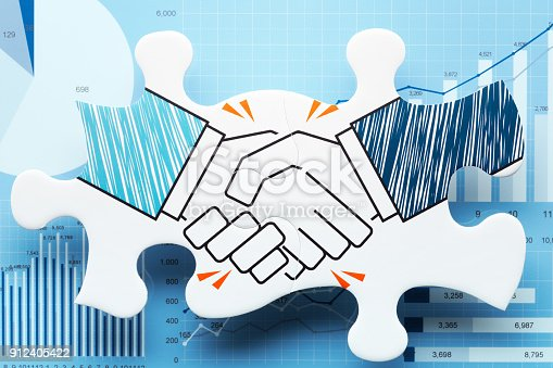istock Handshake jigsaw puzzle pieces on blue charts. 912405422