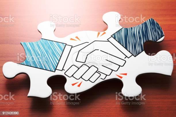 Handshake jigsaw puzzle pieces on wood desk picture id912405390?b=1&k=6&m=912405390&s=612x612&h=y0bi7jufr0brnbsqoduhy9mtusip5bxdpqyt6cavqsw=
