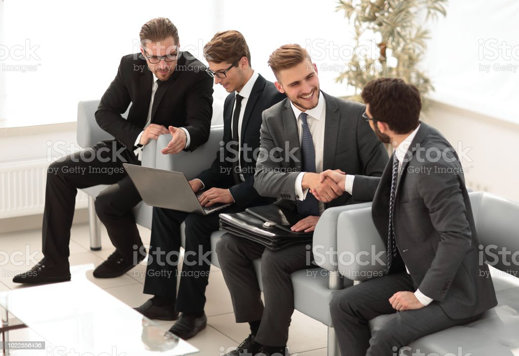 handshake of business people in office waiting room.business concept