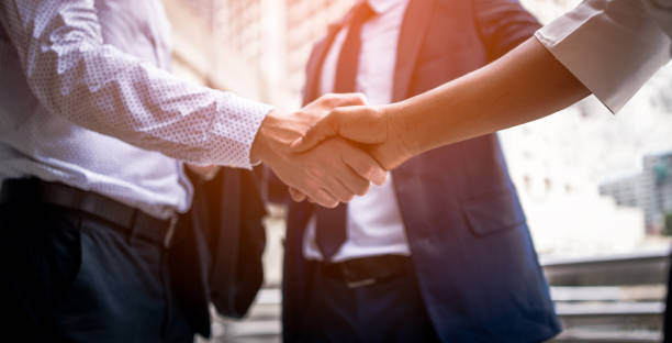 handshake of business people - handshake stock pictures, royalty-free photos & images