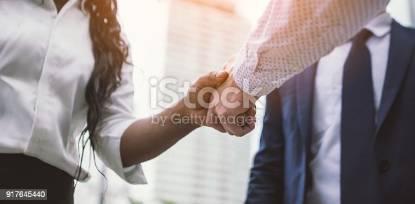 handshake of business People Colleagues Teamwork Meeting .Hold hand and shaking hand in city