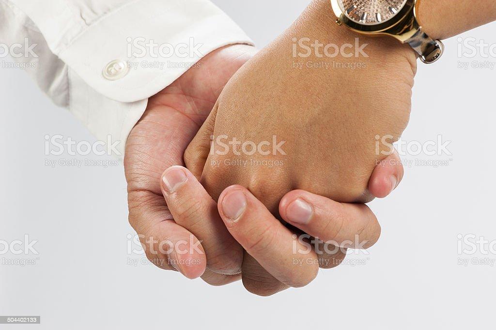 Handshake of lovers stock photo