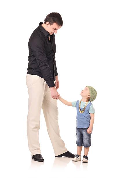 Handshake of man and boy stock photo