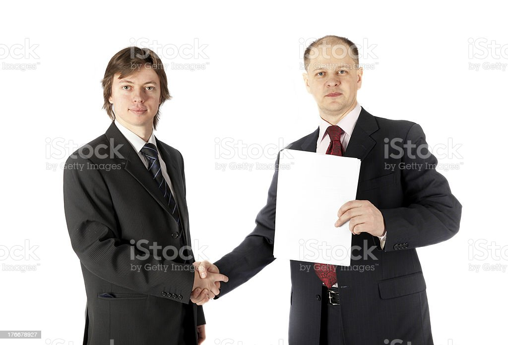 handshake of two businessmen signed a contract royalty-free stock photo
