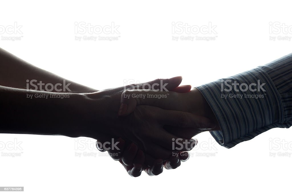 Handshake of two women, a business agreement - silhouette stock photo
