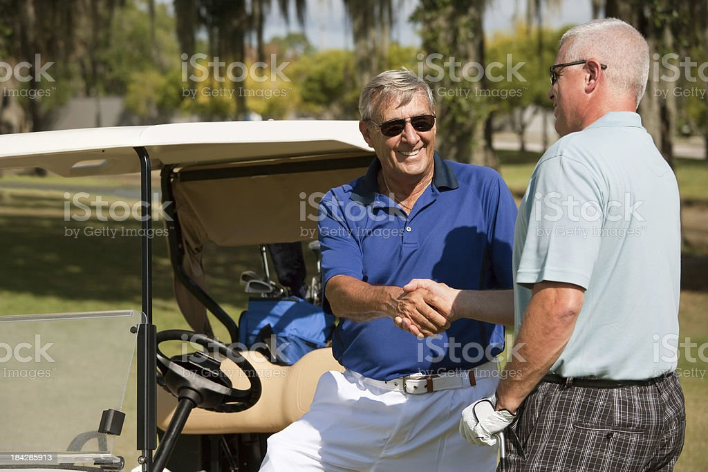 Handshake on Golf course royalty-free stock photo