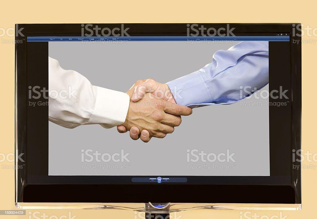 Handshake on LCD Screen royalty-free stock photo