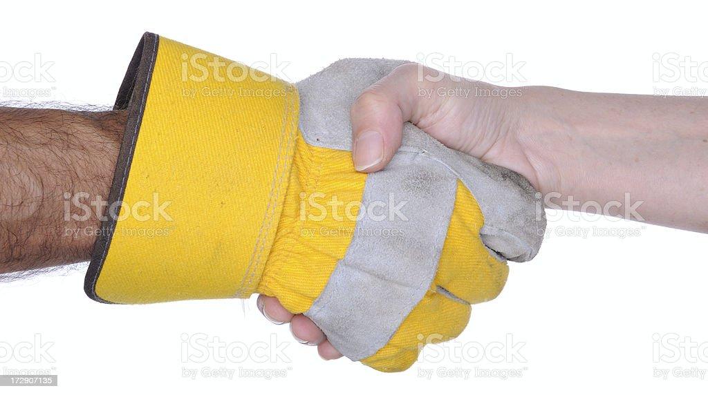 Handshake: One Hand with Work Glove stock photo