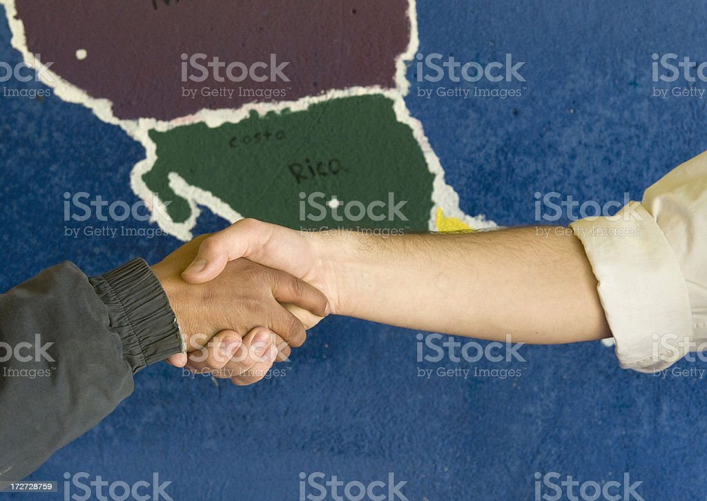Handshake over Central America royalty-free stock photo
