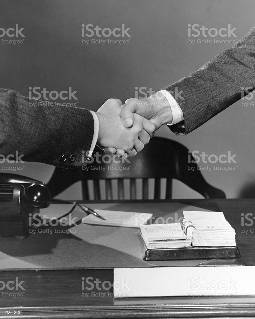 Handshake over desk 免版稅 stock photo