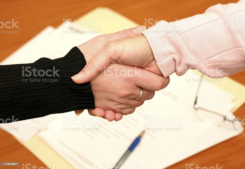 Handshake over Signed Contract royalty-free stock photo