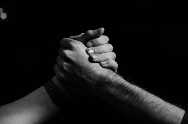 Handshake A handshake between two brothers brother stock pictures, royalty-free photos & images