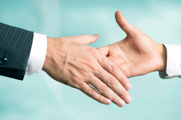Handshake Two men are shaking hands. diplomacy stock pictures, royalty-free photos & images