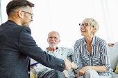 istock handshake senior couple investment business finance hand agent meeting agreement planning home 1286374433