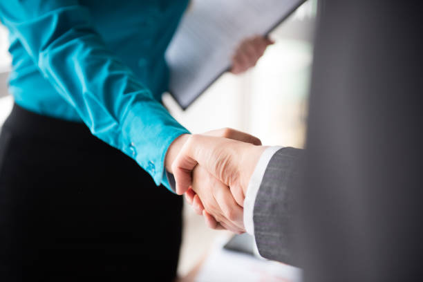 Handshake, two business women, agreement Two business women shaking hands, agreement, contract dealing cards stock pictures, royalty-free photos & images
