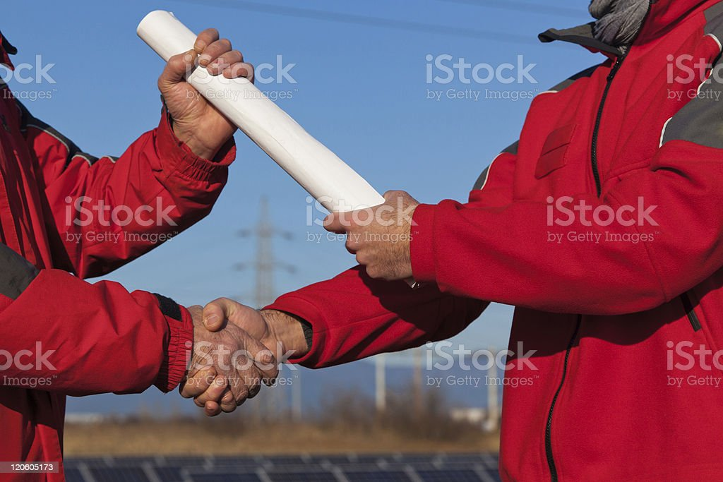 Handshake with Project Plans Delivery royalty-free stock photo