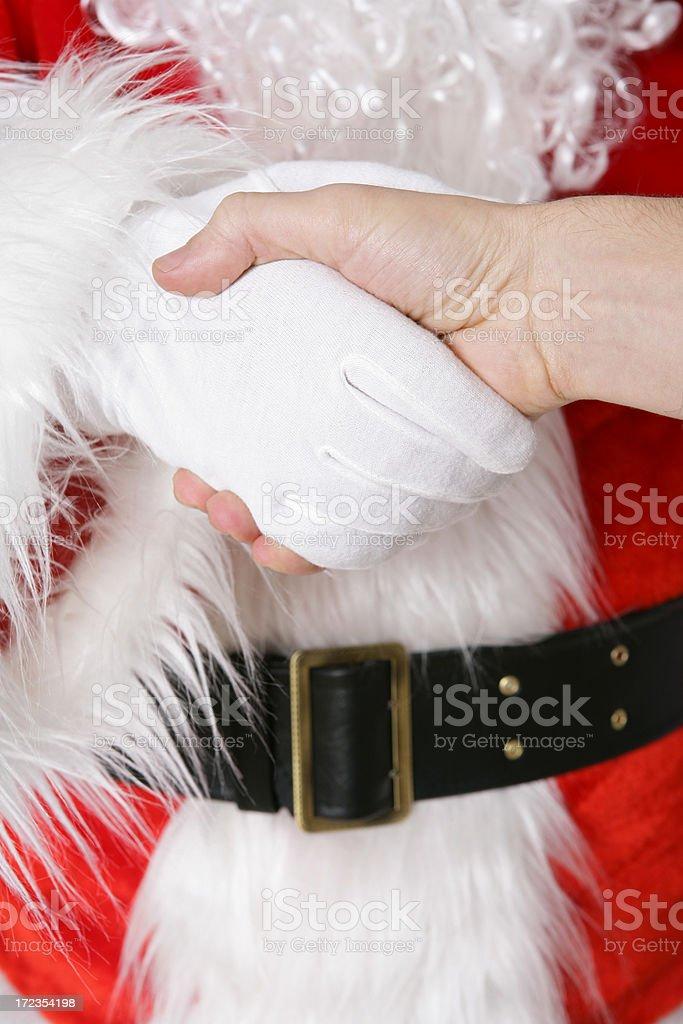 Handshake with Santa royalty-free stock photo