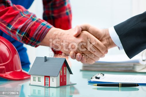 1055059750istockphoto Handshakes after contract signature 511728674