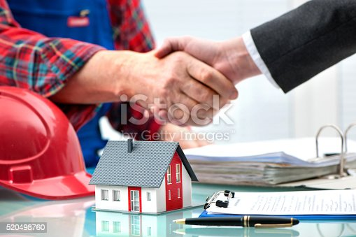 1055059750 istock photo Handshakes after contract signature 520498760