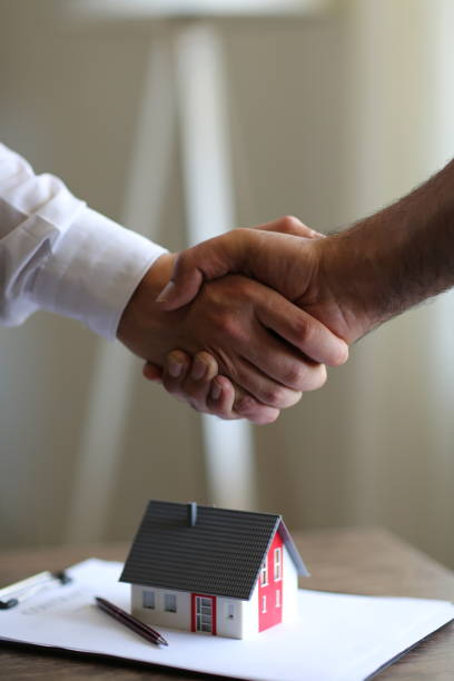 Handshakes with customer after contract signature Handshakes with customer after contract signature mortgages and loans stock pictures, royalty-free photos & images