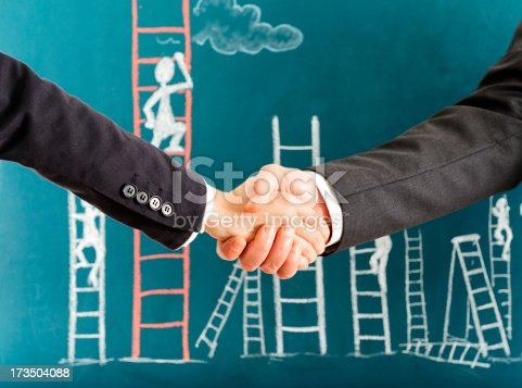 1127097479istockphoto Handshaking and Ladder of Success 173504088