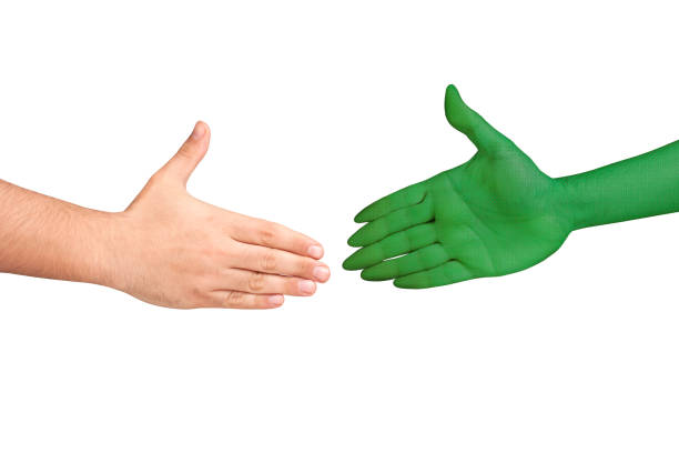 Handshaking human alien hands isolated stock photo
