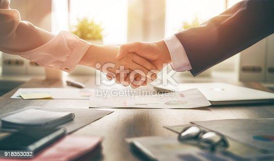 istock handshaking in office 918353032