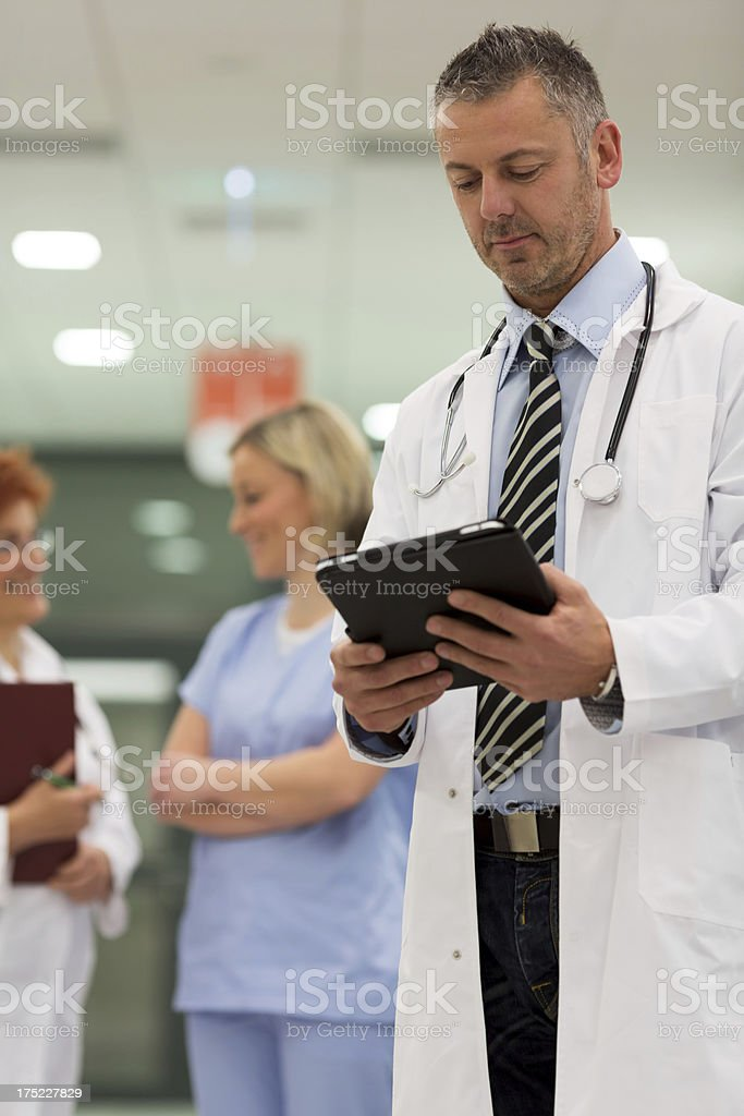 Handsom doctor with touchpad stock photo