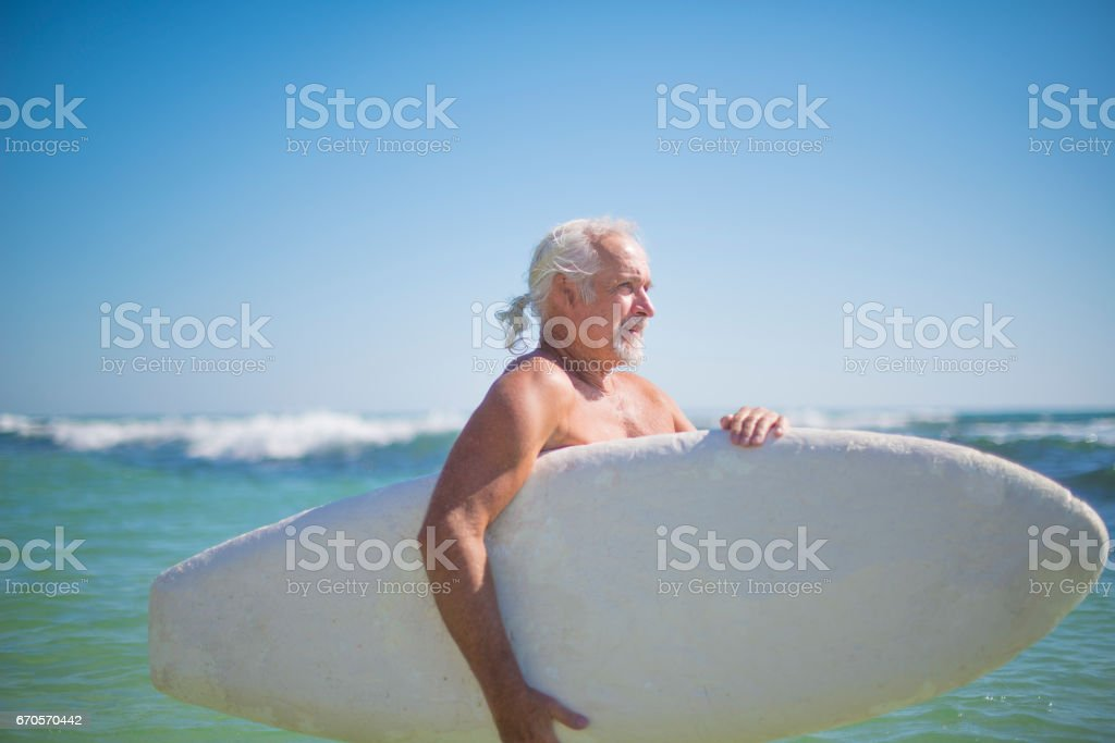 Handsome active senior surfing royalty-free stock photo