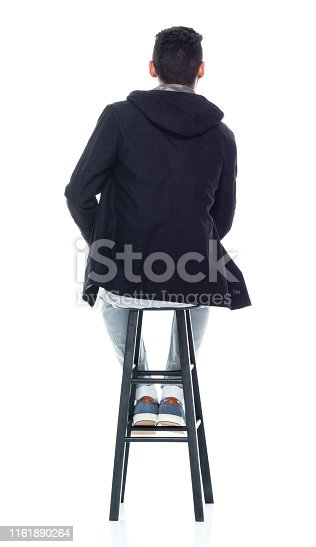 Handsome African American male standing on white background - sitting