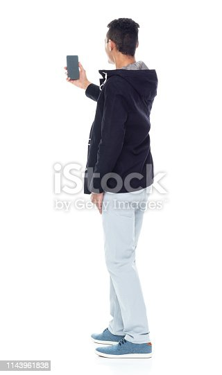 Handsome African American male standing on white background - taking a selfie