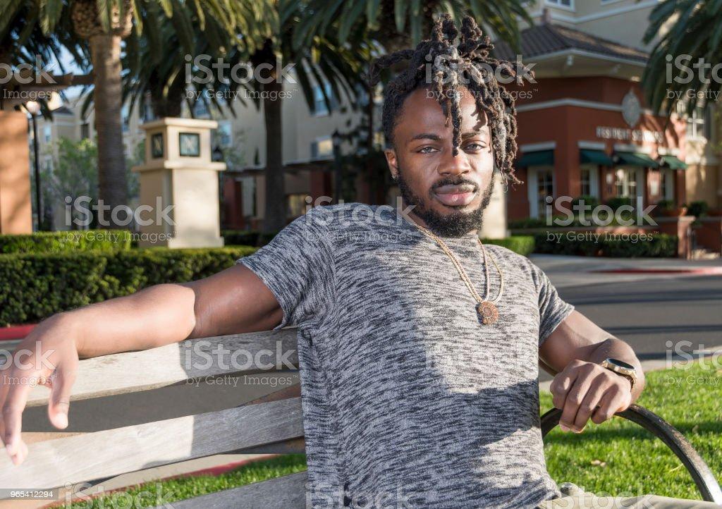 Handsome African American Man Sitting in the Park zbiór zdjęć royalty-free