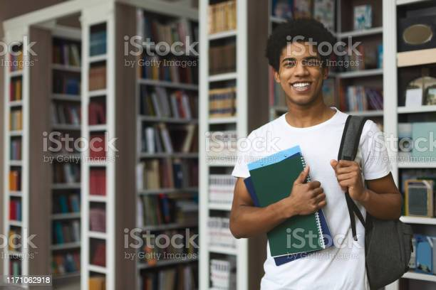 Handsome afro student posing on bookshelves background picture id1171062918?b=1&k=6&m=1171062918&s=612x612&h=f6sqp0kk6l6bzhtzme8s4qdgyvfyaum42kebrpgqpyg=