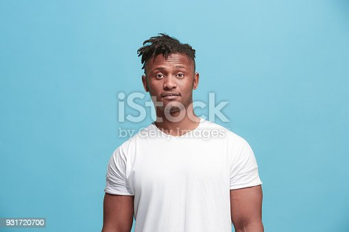 1012628232istockphoto Handsome afro-american man looking suprised isolated on blue 931720700