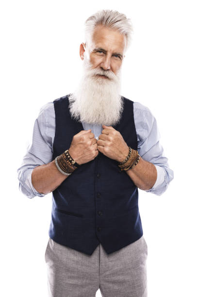 Handsome aged male model posing  on white background stock photo