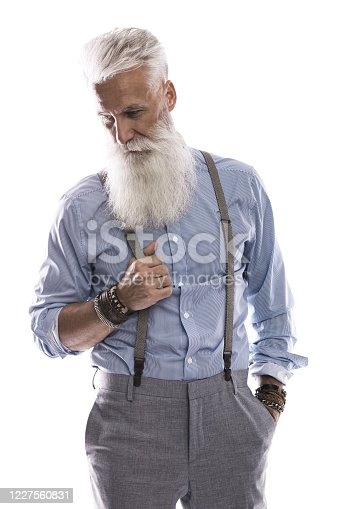 698023272 istock photo Handsome aged male model posing  on white background 1227560831
