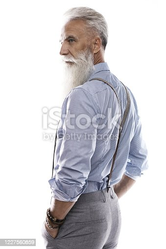 698023272 istock photo Handsome aged male model posing  on white background 1227560859