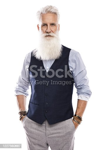 698023272 istock photo Handsome aged male model posing  on white background 1227560887