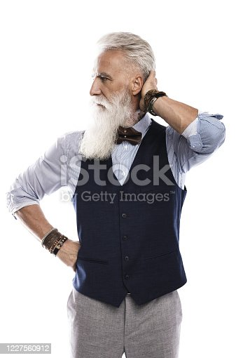 698023272 istock photo Handsome aged male model posing  on white background 1227560912